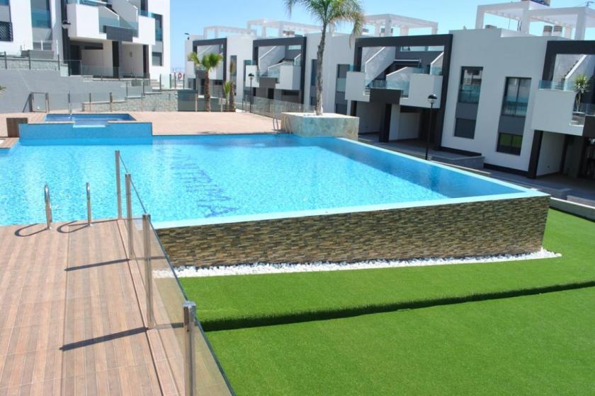 Top floor apartment in Oasis Beach Punta Prima 8 Nº 030 in España Casas