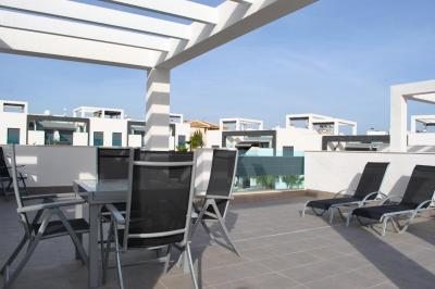 Top floor apartment in Oasis Beach Punta Prima 7 Nº 032 in España Casas